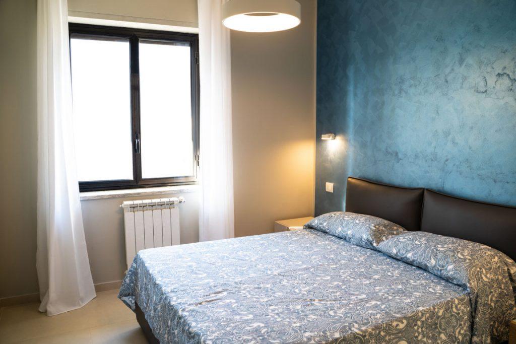 Stanza da letto Gelone Suites